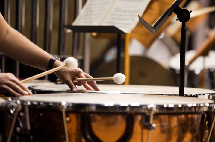 Hands musician playing the timpani in the orchestra closeup